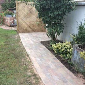 Raised beds and brick pathway