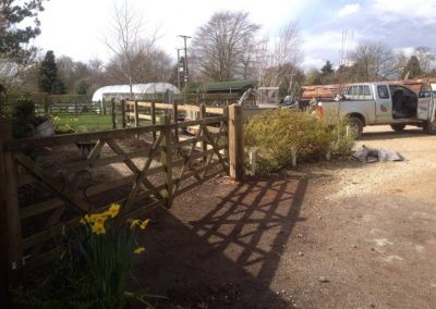 Post and rail fencing with fates at The Lazy Toad Inn